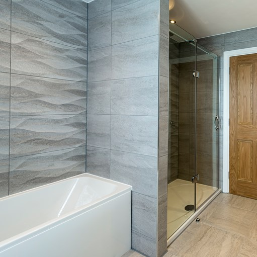 grey luxury wet room and white bath
