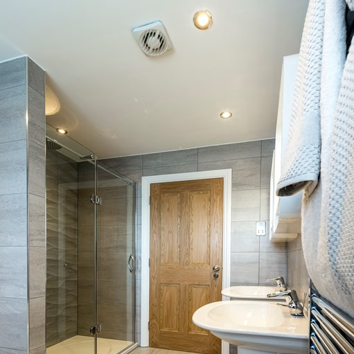 grey luxury wetroom and brown door