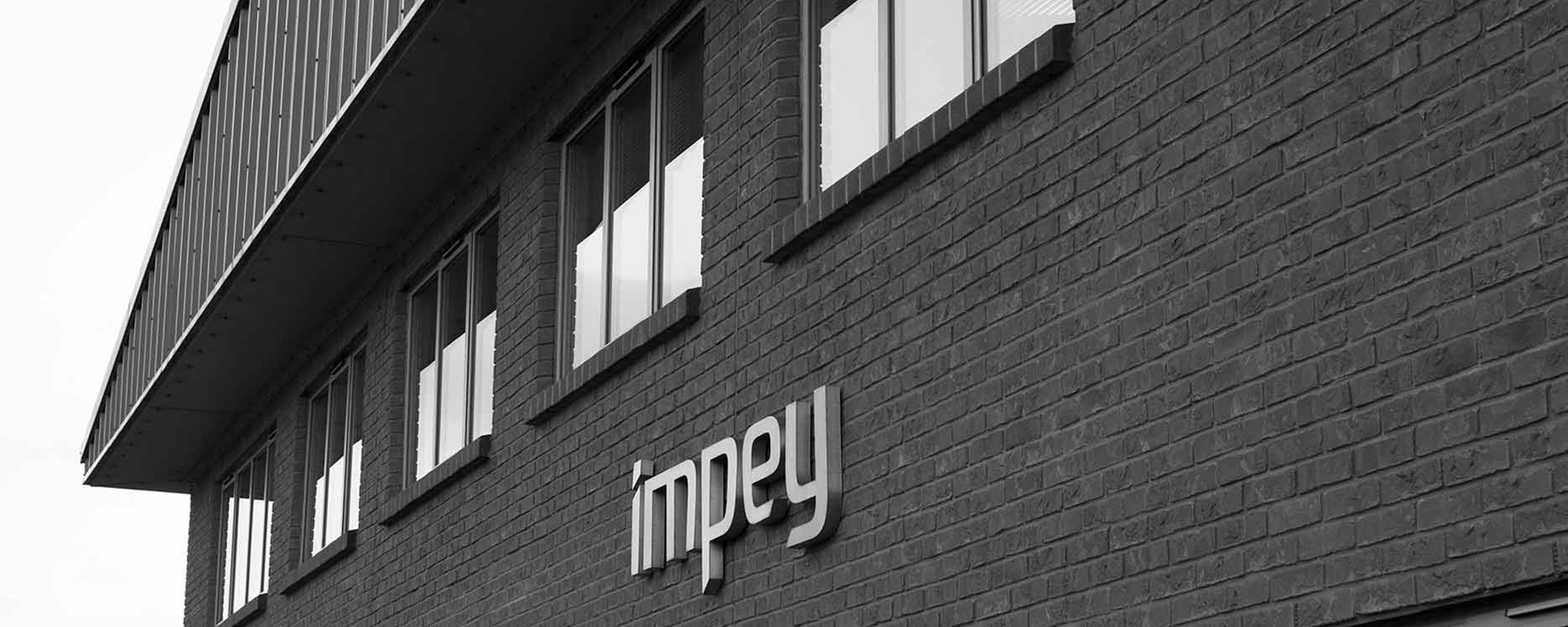 Impey logo on head office building