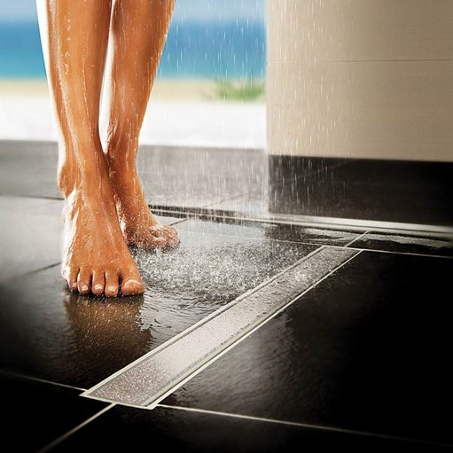 wetroom linear drainage with womens feet